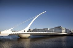 The rotatable Samuel Beckett Bridge is a gleaming bastion of modern architecture and the perfect foyer to Dublin's sparklingly regenerated docklands! Dublin Hotels, Ireland Holiday, Dublin City, Pedestrian Bridge, Emerald Isle, Ireland Travel, Modern Architecture, Tourism, To Go