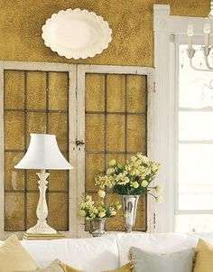 balcony walls-a golden oak wood stain on the rough stucco walls to give them the look of old plaster. Read more: Farmhouse Decor - Illinois Farmhouse Tour - Country Living Old Windows, Windows And Doors, Windows Decor, Recycled Windows, Living Room Windows, Living Spaces, Cottage Windows, Old Window Projects, Window Ideas