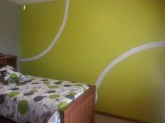 Boy's room.  Tennis ball wall.  For the tennis fanatic like us.