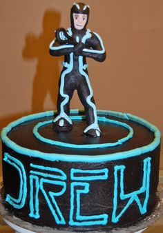 Tron Legacy cake for a boy who also plays lacross. He's holding a lacross stick.