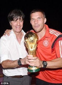 Glory boys: Low and player Lukas Podolski celebrate...