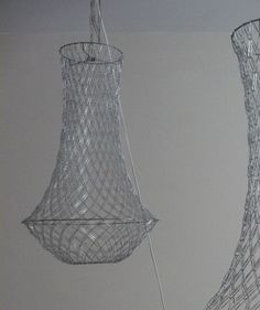 Art Wall: clever design: paperclip chandeliers by redesign technologies.