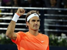 Roger Federer of Switzerland gestures to the crowd after defeating World number one Novak Djokovic of Serbia during their final match on the fifth day of the ATP Dubai Duty Free Tennis Championships on February 28, 2015 in Dubai.