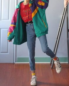 Windbreaker, highly belted jeans and a colourful shirt. Noted.