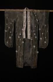 hussein chalayan the tangent flows (MA collection-- clothes buried in the ground with iron filings before being exhumed.)