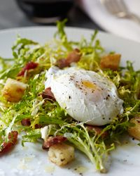 Curly Endive Salad with Bacon and Poached Eggs // More Great Salads with Meat: http://www.foodandwine.com/slideshows/salads-with-meat #foodandwine