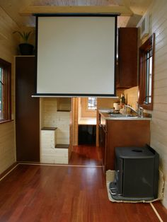 Pull down Movie Screen is hidden in the column beam in tiny house. https://www.facebook.com/media/set/?set=a.584805064932825.1073741837.488310544582278&type=3