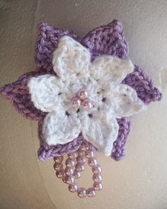 Handmade crocheted flower with 4mm glass pearls. Pearls are sewn into the work.