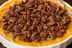 Combining sweet potatoes, butternut squash, maple syrup and a pinch of cinnamon and curry, this Healthy Sweet Potato Casserole wows everyone!
