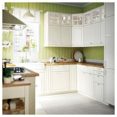 Ikea kitchen with BODBYN off-white drawer fronts, doors and glass doors. Note: Ikea is changing its kitchen cupboard system over the next year or two, country by country. Ikea Bodbyn Kitchen, White Kitchen Cabinets, Kitchen Appliances, Kitchen Units, Glass Cabinets, Green Kitchen, New Kitchen, Kitchen Dining, Kitchen Cook