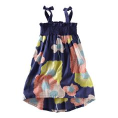 A softly bold bunch of surf lilies floated onto your cotton lawn dress with fun shoulder ties. It floats, it flows, it's an airy, breezy delight.  With a gathered smocked jersey top. Two ties are definitely better than one. Imported.