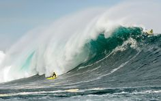 Chilean Ramon Navarro catches a 26-foot swell during the first stop of the 2011 Big Wave World Tour, at Punta de Lobos. Photograph by Alfredo Escobar.