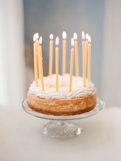 Elegant birthday cake with tall slim candles