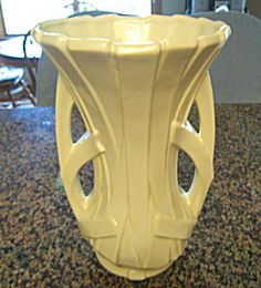 Vintage McCoy Pottery Large Strap Vase (Image1)    Circa: 1946   McCoy Pottery Co. Large vintage McCoy Pottery strap vase. c:1946. Gloss white, very heavy and stands 12 tall    $ 135.00