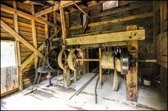 Gearing Up - Pinned by Mak Khalaf The gears and belt drives for the operation of the mill stones on the floor above to grind the grain to flour....at the West Point Mill on the Eno. Fine Art oldretrovintage by TomShacochis