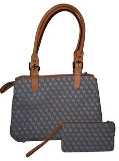 Dooney Bourke With Matching Wristlet Have This In A Lighter Denim Blue