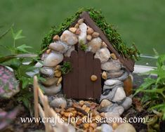 Cute little fairy house made of stones and Popsicle sticks