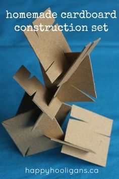 Toddlers and Preschoolers who love to build will enjoy this homemade cardboard construction set. Raid your recycle bin for sturdy cardboard to make this homemade building set. It's great for fine motor skills, to challenge your kids critical thinking. Happy Hooligans, Craft Activities, Toddler Activities, Motor Activities, Karton Design, Diy For Kids, Crafts For Kids, Crafts Toddlers, Diy Pour Enfants