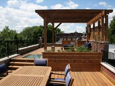 This Chicago rooftop features a cedar pergola with lounge seating and fire pit as well as a built-in grill and bar area and dining space.