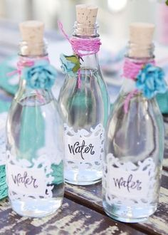bottles of water for people since it's an outdoor summer ceremony...but do your colors instead of the purple and blue...