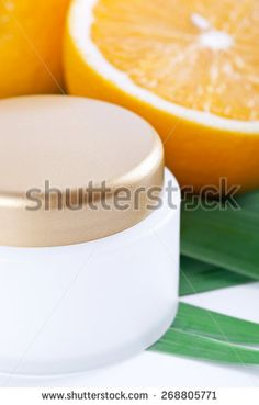Facial cream with vitamin C, Orange fruit skincare - stock photo