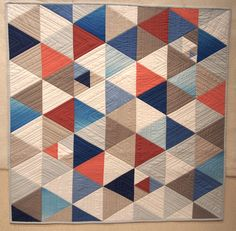 Mischa's quilt. Triangles, solids, modern