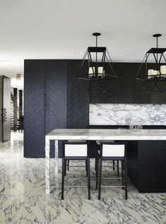 marble and chevron clad wood make this kitchen eye catchy and interesting