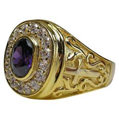 Our Gold Bishop Ring a piece of true craftsmanship! It features a silver core covered with thick gold plating with clear crystals and a huge amethyst insert