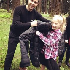 David sharing his jacket with a cold Hannah Loyd. How cute is this?