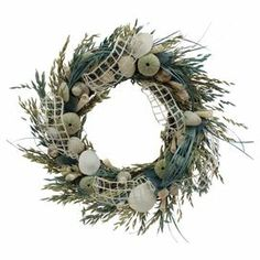 """Artful on its own or anchoring a beach-chic vignette, this eye-catching wreath featuring avena, grass, jute, and assorted shell accents.   Product: WreathConstruction Material: Avena, grass, shell, jute, sea glass and twigColor: Multi Features: Includes natural grasses and shellsDimensions: 20"""" Diameter"""