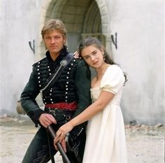 Talking of how good men look in Regency costume: Sean Bean as Richard Sharpe, with a young Elizabeth Hurley in suggestive pose!