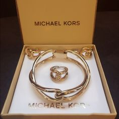 Michael Kors bracelet,earrings,ring sets gold Authentic Michael Kors bangles,ring,earring sets gold. Looks new no scratches at all. The ring size 6 very pretty jewelry MK gold sets. Michael Kors Jewelry
