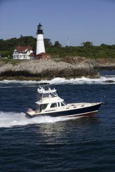 Portland Head Light in Maine with the Sabre 54 Fly Bridge passing by