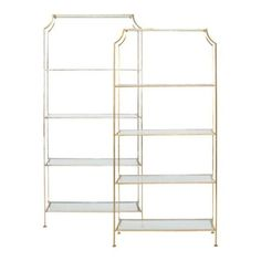 """This elegant etagere looks beautiful in almost any room setting. Featuring hand applied silver leaf and clear glass shelves that are set into an iron frame, this piece measures 84"""" high X 12"""" deep X 3"""