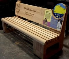 Oak bench with interpretive panels and routed text