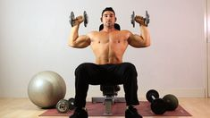 Target your anterior deltoids with the seated dumbbell overhead press, a primary compound exercise that synergistically works your triceps and upper pecs. Dumbbell Exercises For Men, Dumbbell Workout For Beginners, Dumbbell Workout Routine, Arm Exercises, Workout Gear, Arm And Shoulder Exercises, Dumbbell Shoulder, Shoulder Workout, Pop Workouts