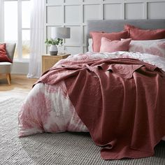 Introduce coastal charm to your bedroom with the Coral Bay quilt cover. Crafted from 250 thread count cotton, a painterly design of coral in soft blue hues is finished with a filled piping trim and stylish printed reverse. Calming and contemporary, complete the look with European pillowcases. #quiltcover #duvetcover #doonacover #coastalstyle #coastaldecor