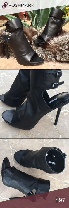 """NWOTLeon Max Black Edina Peep Toe Stilettos NWOT❣️Leon Max black leather 'Edina' heels. Amazing buttery soft leather with a sexy 4-3/4 inch stiletto heel, ankle cuff with buckles, and a concealed Velcro closure. The cut out heel and toe make these heels stunning and chic with jeans or that little black dress Small scratches on edge of right heel. Hardly noticeable. """"Leon Max"""" Shoes Heels"""
