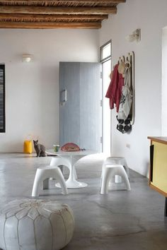 Polished concrete floor, and exposed beams.