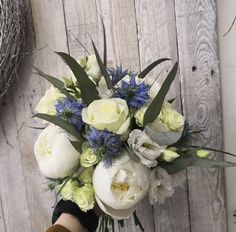 White peony roses, roses, spray roses and lisianthus with a touch of blue nigella and eucalyptus to really lift the creams and whites. Always a classic and elegant colour scheme. Bridal Bouquet Blue, Wedding Flowers, Wedding Day, White Peonies, Spray Roses, Nigella, Peony, Special Day, Color Schemes
