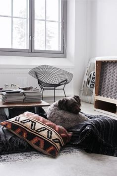 neutrals + kilim pillows + floor pillows via wit and delight