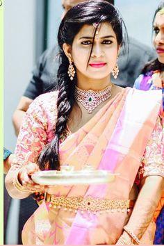 South Indian bride. Diamond Indian bridal  jewelry. Jhumkis.Pale pink kanchipuram sari.side Braid with fresh jasmine flowers. Tamil bride. Telugu bride. Kannada bride. Hindu bride. Malayalee bride.Kerala bride.South Indian wedding