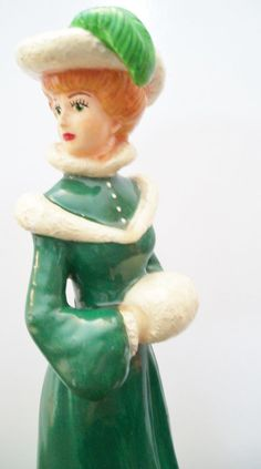 "Gibson Girl lady wearing green dress figurine by ALEXLITTLETHINGS Vintage figurine of a fancy lady wearing a long green fur trimmed dress, green fur trimmed hat with a feather in it, warming her hands in a muffler. She reminds me of a Gibson girl. 8-3/4"" Made of plaster. Marked ""Kim 1947""  #CollectibleFigurine #alexamigos"