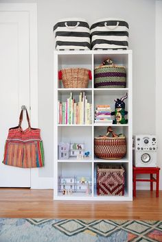 Ikea shelving with alternative baskets! Also height means babies can reach some stuff but not all! From Vivian's Vivacious Nursery on Apartment Therapy