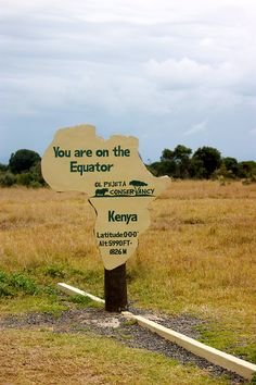 The Equator Line in Kenya. -Goal: have one foot in the northern hemisphere, and the other foot in the southern hemisphere.