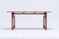 Tamazo design was inspired by the beauty of boat construction. The main joist, rungs, carpenter's joints - the harmony of the construction- all of those elements were designed in tribute to the old classic art of boat building. The wooden construction of Tamazo table is made of oak, walnut, or in the mix of wooden top with plywood legs. It can be finished with natural oils, or varnished. The glass table top reveals the richness of Tamazo's base. www.stfurniture.com