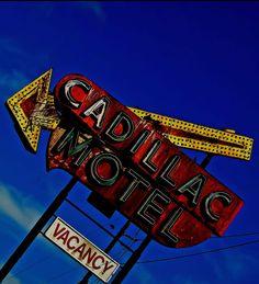 Cadillac Motel - vintage neon sign with arrow