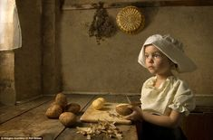 Girl with potatoes: Mr Gekas uses light and shade to recreate the work of famous Dutch portrait painters such as Rembrant