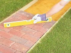 Create a welcoming entrance to your home by laying a brick or paver walkway.