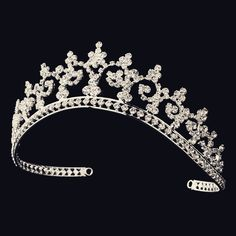 This tiara features an elegant pattern of silver plated vines and rhinestones. Delicate and sweet, it is the perfect accessory to your bridal hair style. The ornamental portion of this piece measures